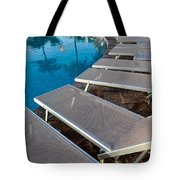 Chairs Around Hotel Pool Tote Bag by Brandon Bourdages