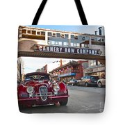 Classic Cannery Row - Monterey California With A Vintage Red Car. Tote Bag
