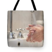 Cleaning Her Hands Tote Bag