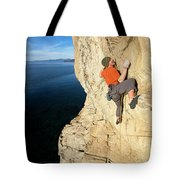 Climber Reaches For Hand Hold Tote Bag
