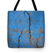 Close Up Of Cracks On A Blue Painted Tote Bag