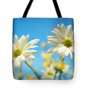 Close-up Of Daisies Against A Blue Tote Bag