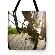 Close Up Of Wheel Of Bicycle On Road Tote Bag