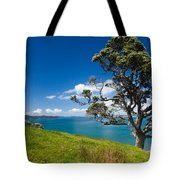 Coastal Farmland Landscape With Pohutukawa Tree Tote Bag