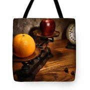 Comparing Apple And Orange Tote Bag