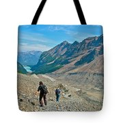 Couple Hiking On Plain Of Six Glaciers Trail  In Banff Np-albert Tote Bag