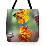 Couple Holding Autumn Leaves Tote Bag
