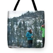 Couple Standing By A Campfire Tote Bag
