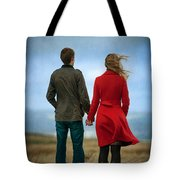 Couple Standing On Windy Moorland Tote Bag