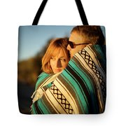 Couple Wraps Themselves In A Blue Tote Bag