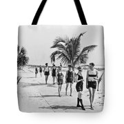 Couples Strolling Along The Pathway On The Beach. Tote Bag