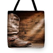 Cowboy Boots On Wood Floor Tote Bag