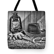 Cowboy Hat And Rodeo Lasso In A Black And White Tote Bag by Paul Ward