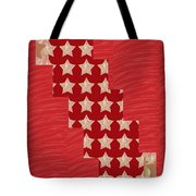 Cross Through Sparkle Stars On Red Silken Base Tote Bag by Navin Joshi
