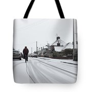 Cyclist In The Snow Tote Bag by Tom Gowanlock