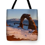 Delicate Arch With Snow At Sunset Arches National Park Utah Tote Bag