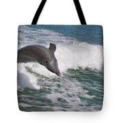 Dolphin Riding The Waves Tote Bag