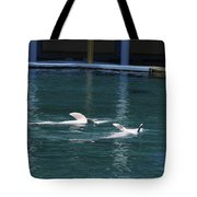 Dolphins Swimming Upside Down As Part Of Show Tote Bag