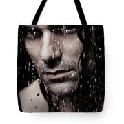 Dramatic Portrait Of Young Man Wet Face With Long Hair Tote Bag
