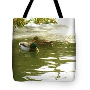 Duck Swimming In A Frozen Lake Tote Bag