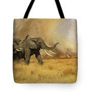 Elephants Moving Before A Fire Tote Bag