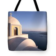 Famous Orthodox Church In Santorini Greece At Sunset Tote Bag by Matteo Colombo