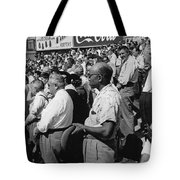 Fans At Yankee Stadium Stand For The National Anthem At The Star Tote Bag by Underwood Archives