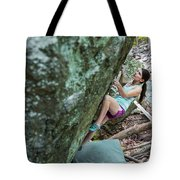 Female Athlete Climbing On Boulder Tote Bag