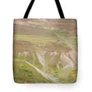 Female Hiker Standing With A Backpack Tote Bag
