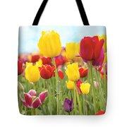 Field Of Tulip Flowers Against Blue Sky Tote Bag