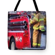Fireman On Back Of Fire Truck Tote Bag