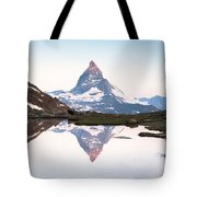 First Light On The Summit Of Matterhorn Tote Bag