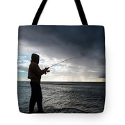 Fisherman Fishing While Storm Blows Tote Bag