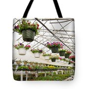 Flowers Growing In Foil Hothouse Of Garden Center Tote Bag
