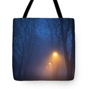 Foggy Avenue Of Trees With Path At Night No People Tote Bag