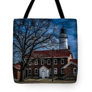 Fort Gratiot Lighthouse And Buildings With Clouds Tote Bag