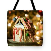 Gingerbread House Against A Background Of Christmas Tree Lights Tote Bag