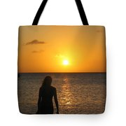 Girl Silhouetted On A Beach At Sunset Tote Bag