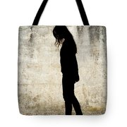 Girl Walking In Front Of Cement Wall Tote Bag