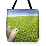 Girls Feet On Grass With Flowers Tote Bag
