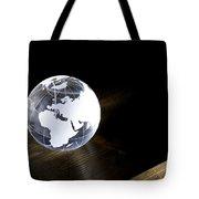 Glass Globe On Wooden Floor Tote Bag