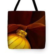 Golden Ornament With Red Ribbons Tote Bag