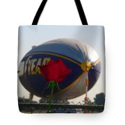 Goodyear Blimp With Red Rose Tote Bag by Jeff Lowe