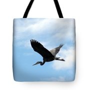 Great Blue Heron Flying Past The Clouds Above Trojan Pond Tote Bag