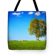 Green Field Landscape With A Single Tree Tote Bag
