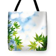 Green Leaves On Mottled Cloudy Sky Tote Bag