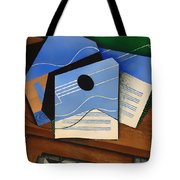 Guitar On A Table Tote Bag