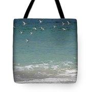 Gulls Flying Over The Ocean Tote Bag