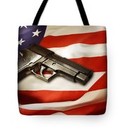 Gun On Flag Tote Bag by Les Cunliffe