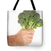 Hand Holding Broccoli Tote Bag